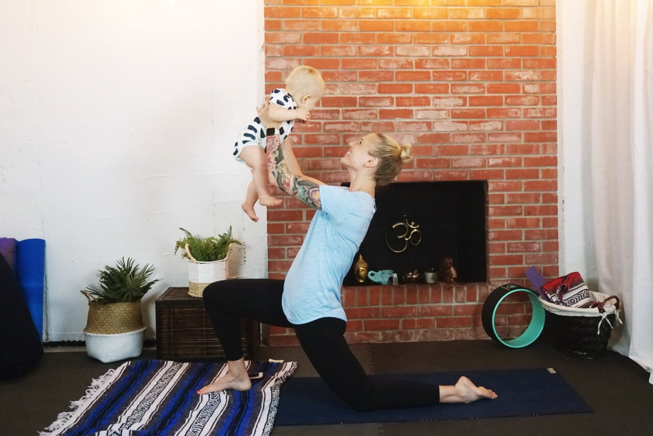 Yoga with a cute 20-lb dumbbell