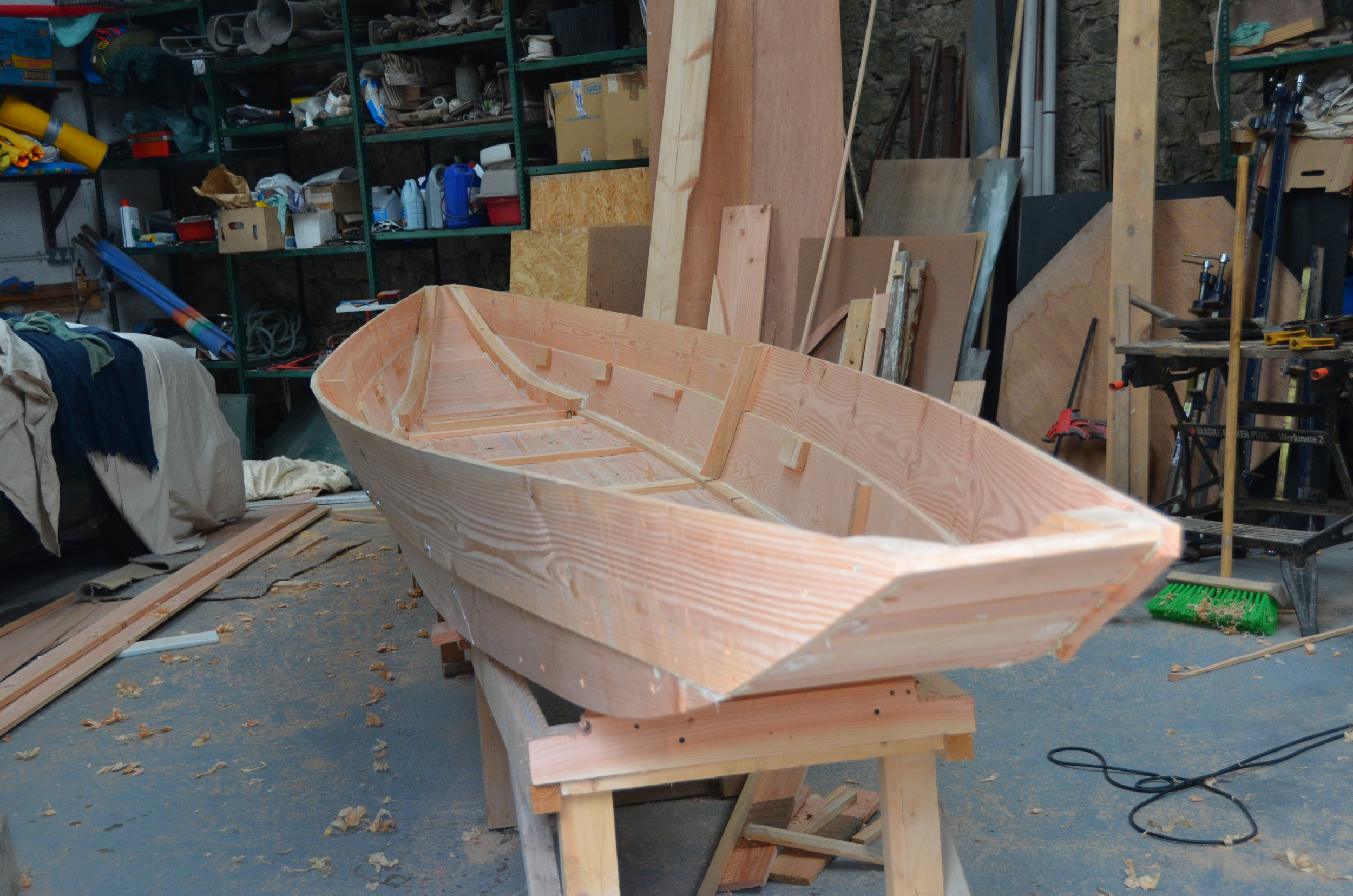 This hull was built while on a visit to Ireland in 2013 , I built the basic hull from the lines of old boats and from some written instructions relating to dimensions which we found in my grandfathers house. The boat is being finished by the owner and we will post some more pictures when he has  completed   the boat.