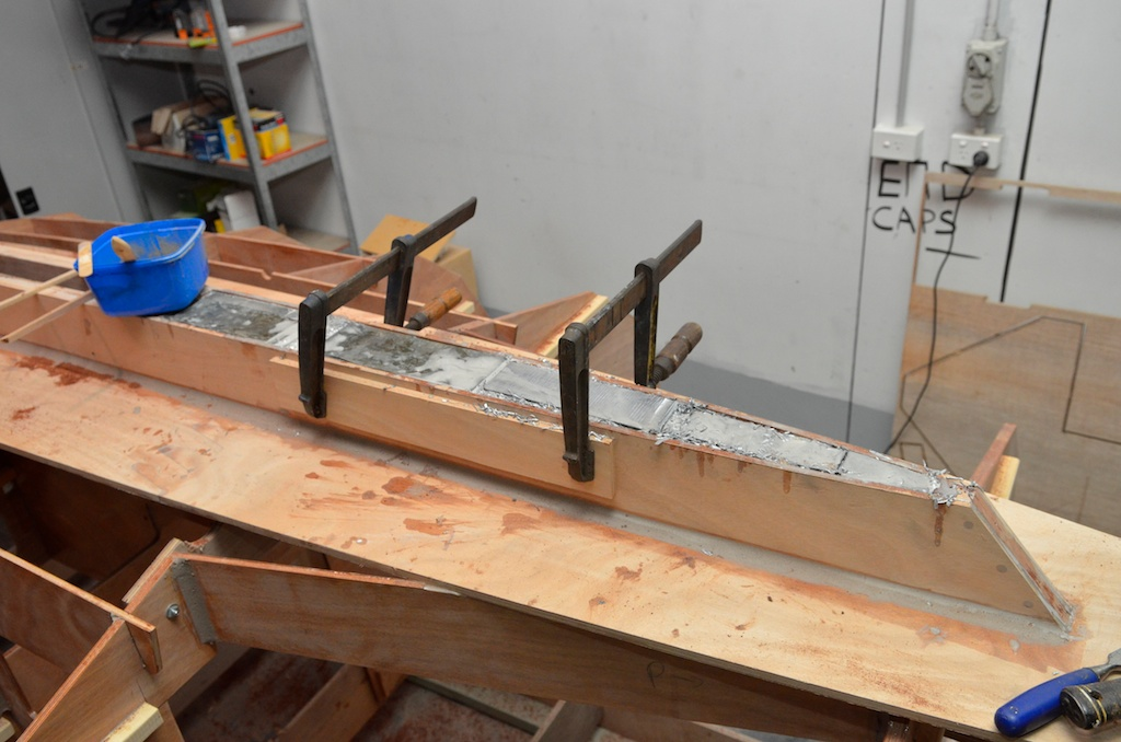 As the keel fills I used clamps to prevent the keel from splaying as I pack the shavings and epoxy in