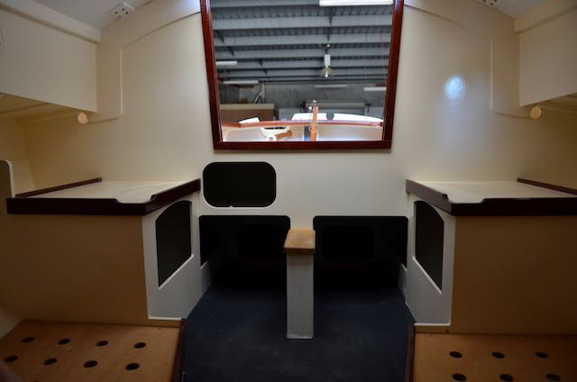 Companionway looking aft, the spaces either side of the centreboard case are for a port-potti and esky.