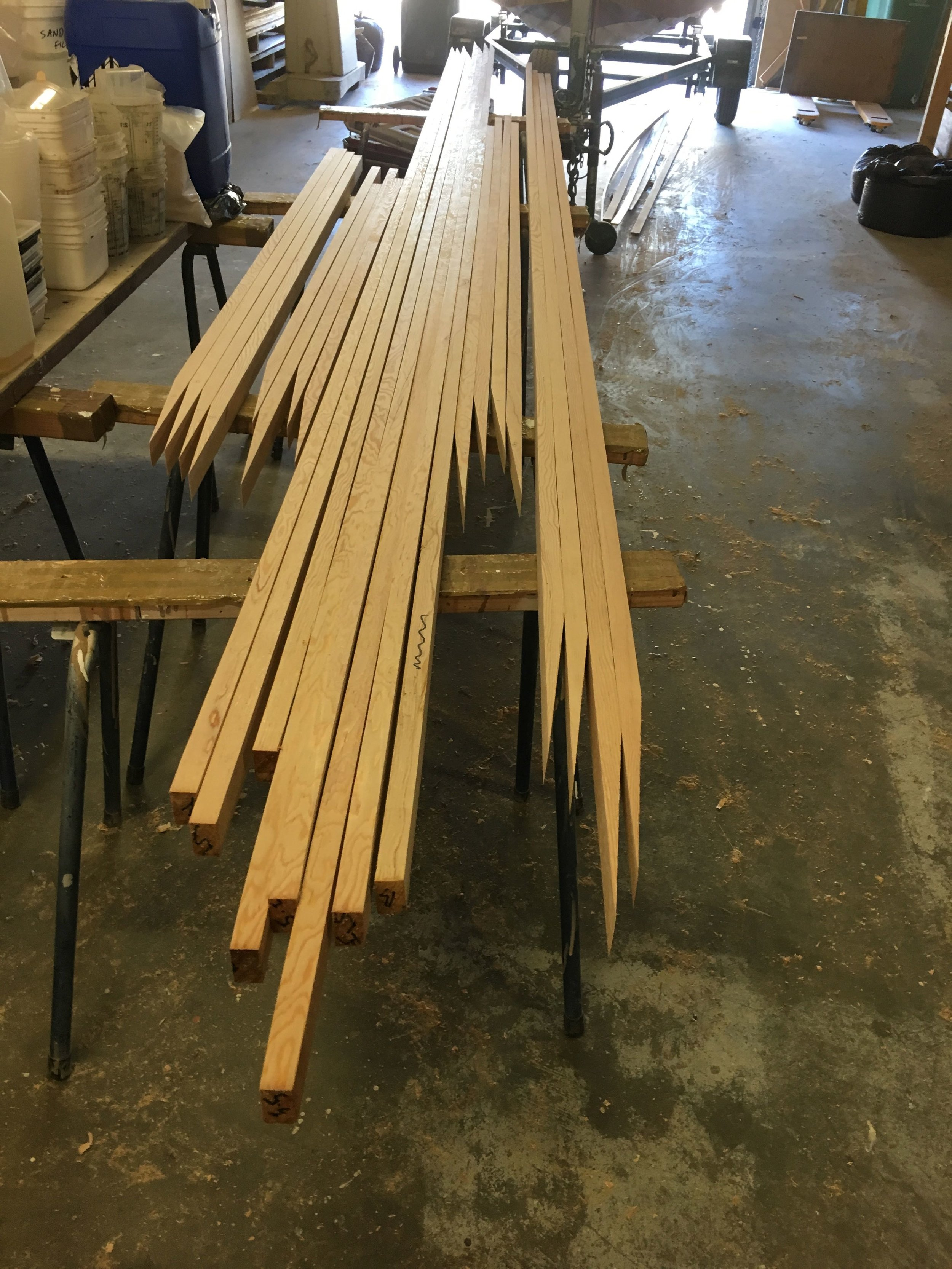 Staves with scarfs cut ready to glue .