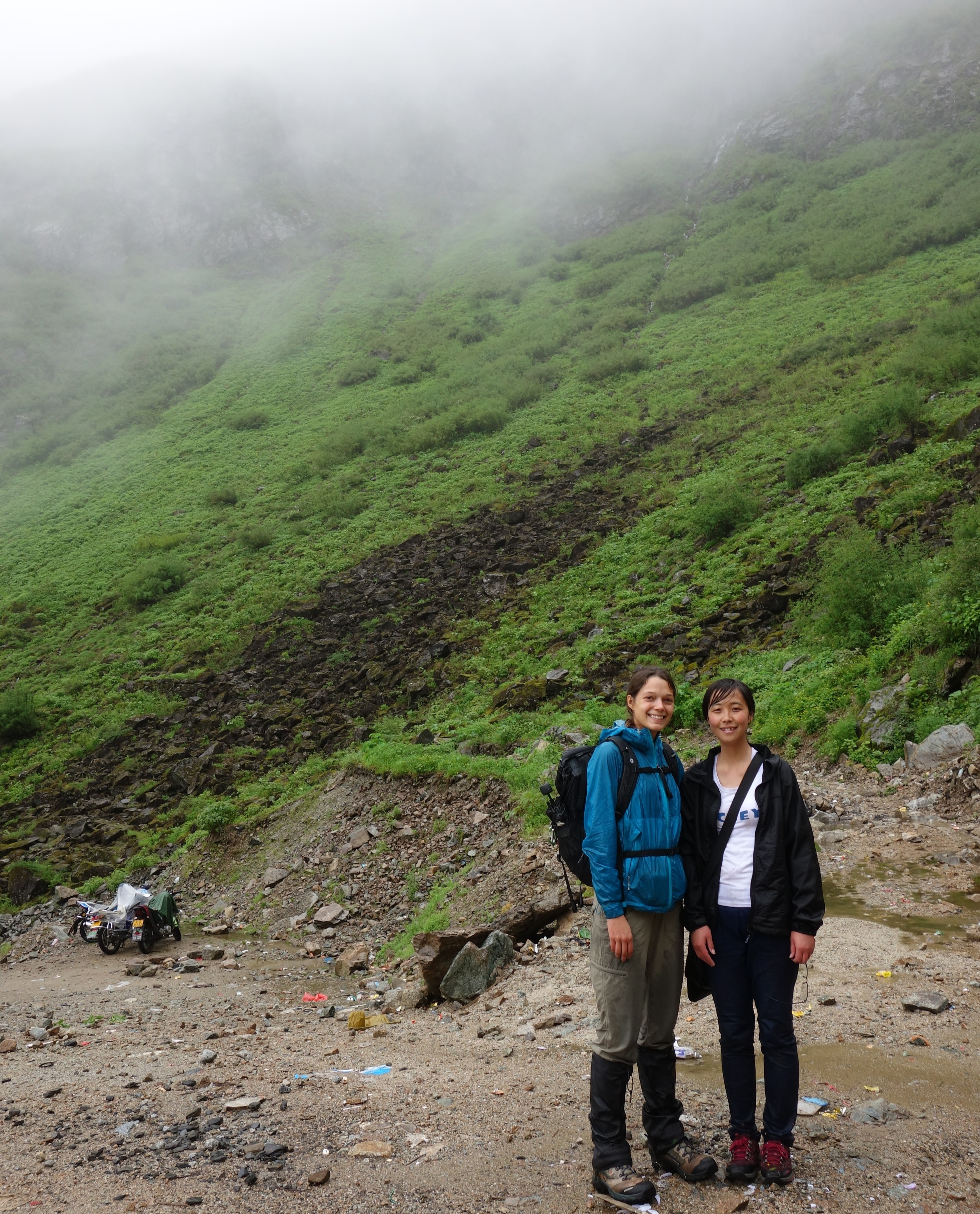 Ya-Ping and me after a long day of hiking in the pouring rain. No, we did not ride those dirt bikes up. We never saw another person the entire 10 hours we spent out there but Yaping said they were probably medicinal plant collectors from the local village.