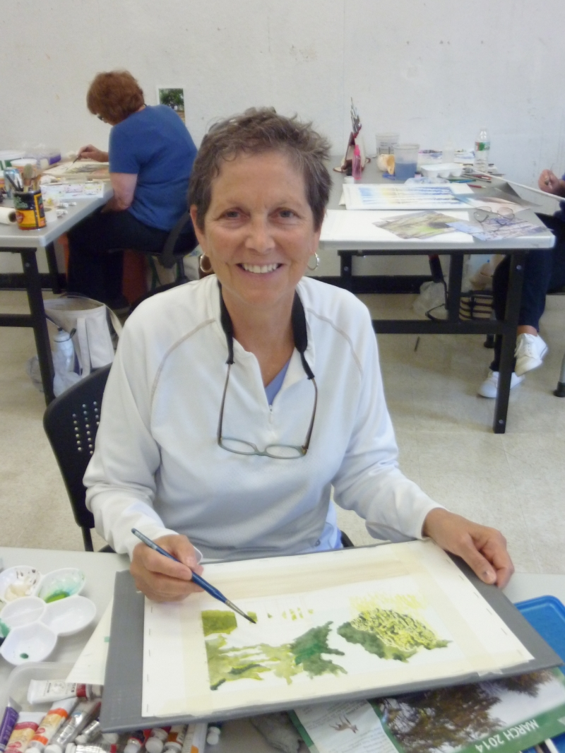 Marsha practices laying wet on wet washes in colors that were bolder than she was used to, as well as using masking techniques.