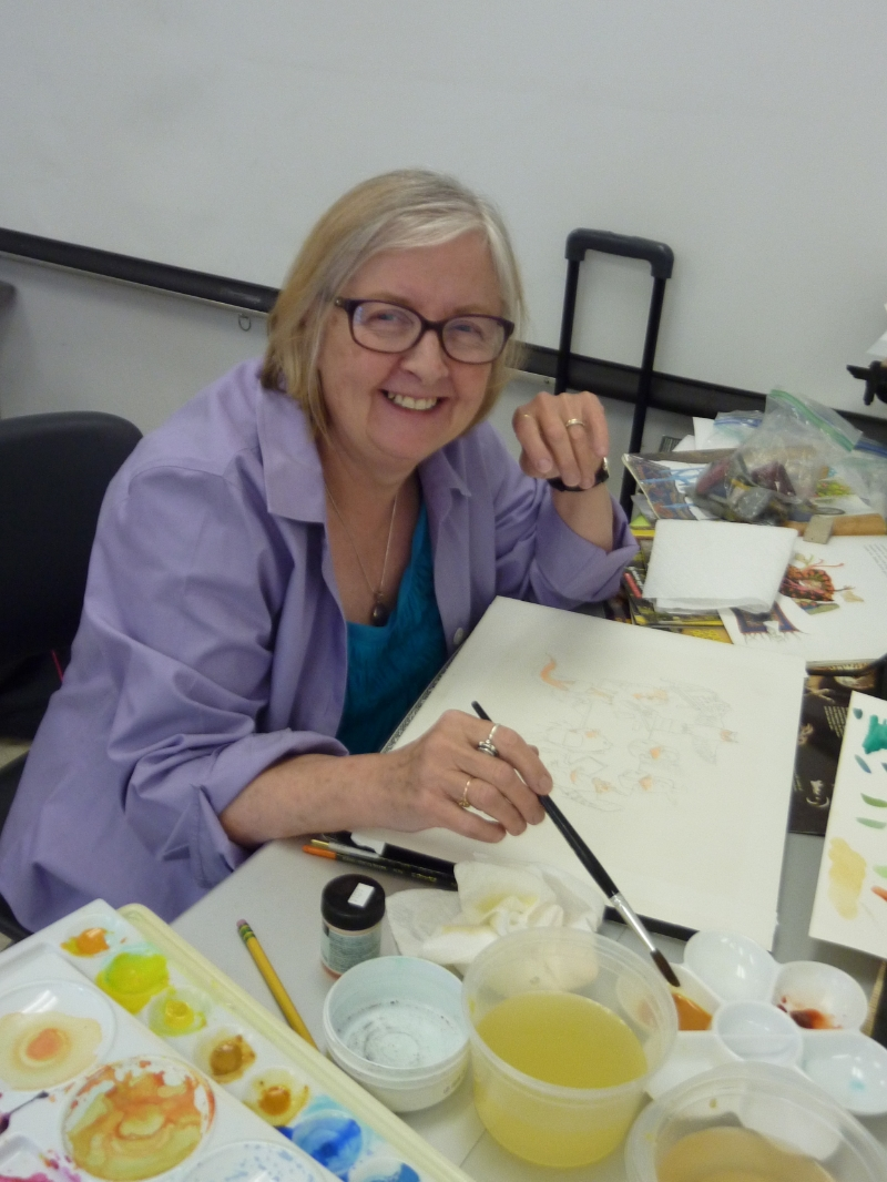 Sue worked on an illustration of animals in a classroom.