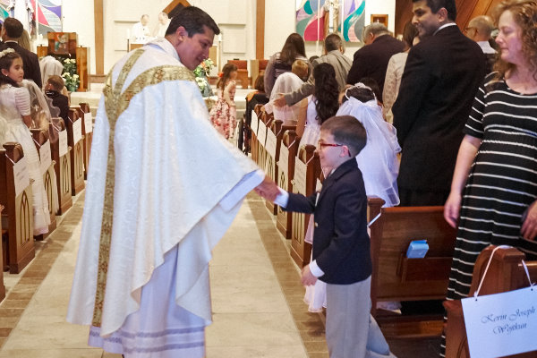 Father visited each First Communicant at the sign of peace