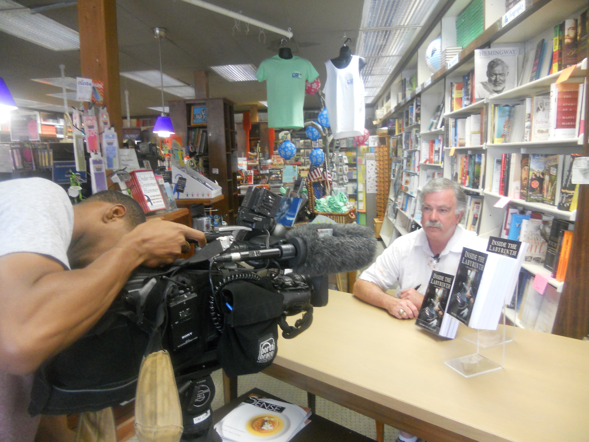 "While at Page & Palette Books, in Fairhope, AL, Bobby was interviewed by a local TV station about ""Inside the Labyrinth"""