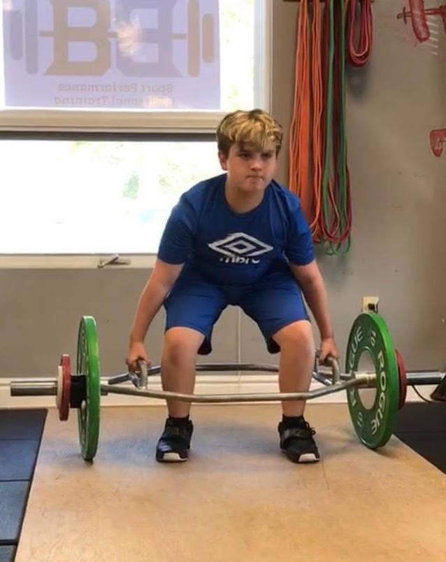 11-year-old Colby trap bar deadlifting 100lbs
