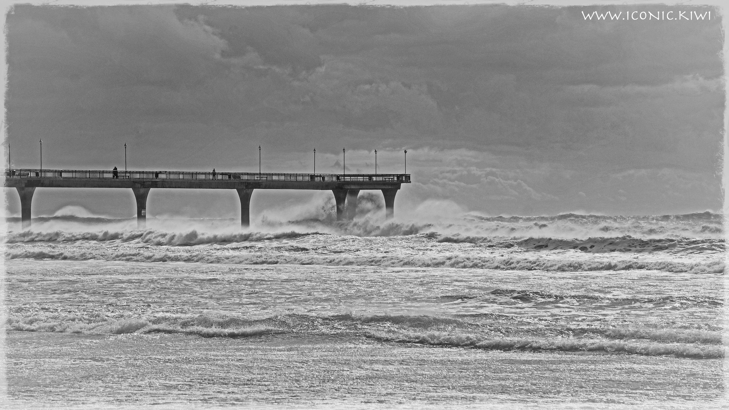 Christchurch Pier, where stormy waves mingle with the clouds