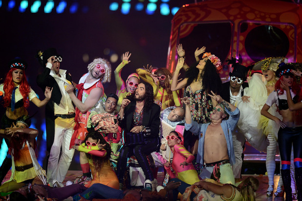 The 2012 London Olympics closing ceremony, with Russell Brand (to his left, pink glasses and arm raised).