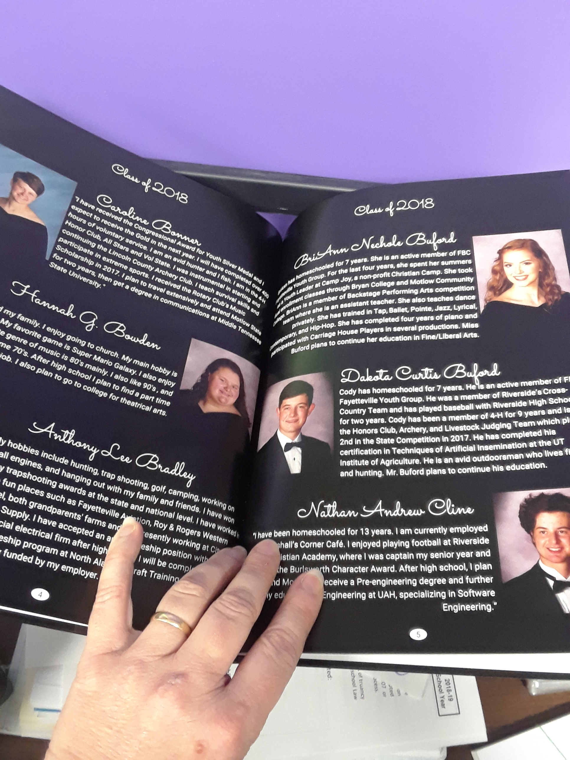 Class of 2018 is featured with portraits and mini-bios.