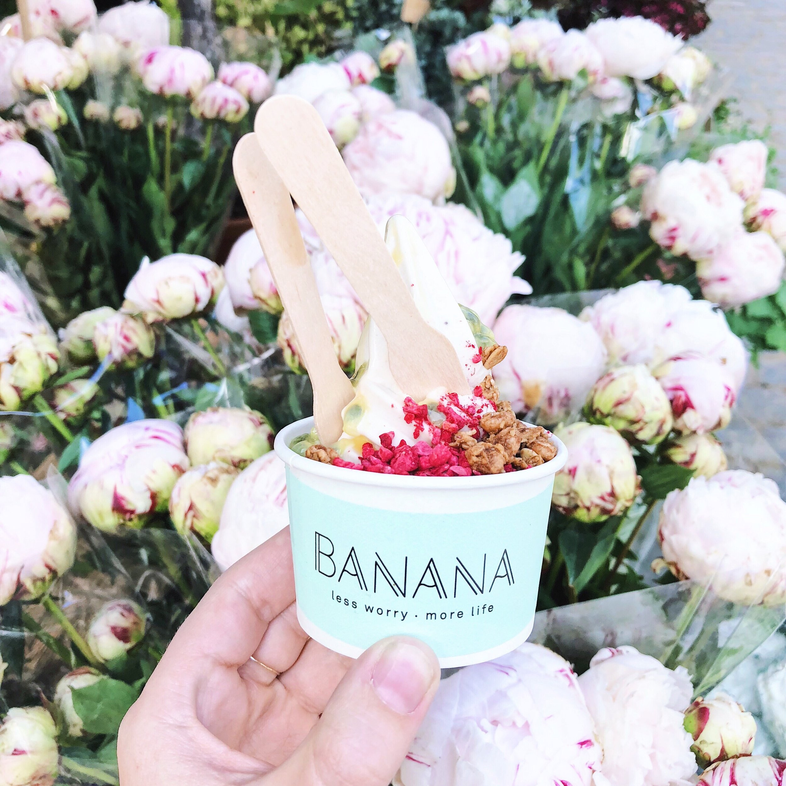 """Banana """"nice cream"""" with passionfruit, dried berries and granola."""