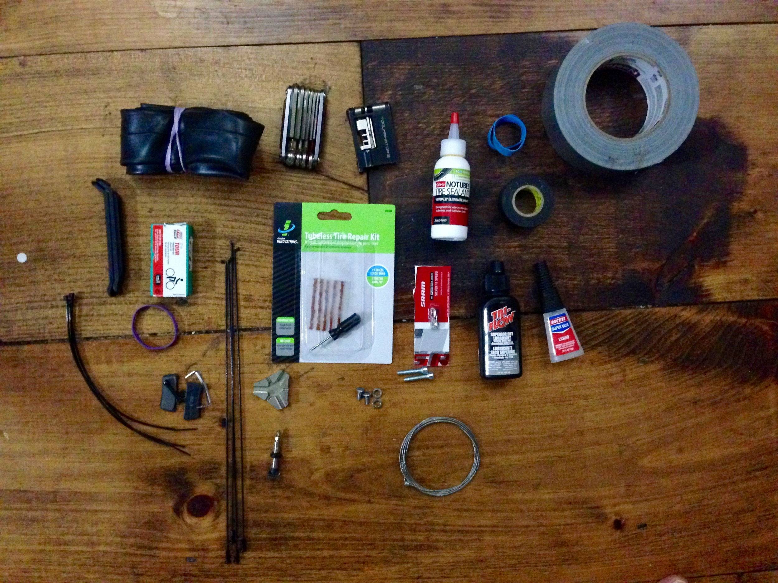 Bike repair knoll: bike tube, multi tool, chain break that someone almost broke, #stans, rubber bands, electrical and duct tape (yes I wrapped around my handlebars) tire lever (but I won't use them promise @tophervalenti ) patch kit, 3 x extra spokes, tubeless patch kit, master link for @srammtb 1 x 11 😍, chain lube, super glue, brake pads, zip ties, spoke wrench, extra valve/core, nuts, dérailleur cable.
