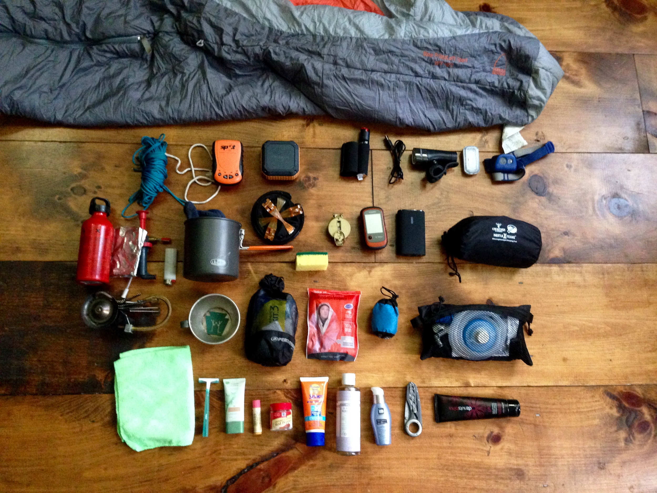 Gear knoll: 20 deg sleeping bag, head mosquito net, GPS spot tracker,#omakerspeaker, dog pepper spray,@blackburndesignfront lights, headlamp,#whisperliteinternational, fuel canister (no fuel inside), GSI stove set, GSI camp coffee pour-over thingy, trusty compass,#garminetrex20,#Anker2nd gen 9600mAh external battery pack,#klymitx-frame sleeping pad (camo print 😉), camp cup,#LLWHtoken, first aid kit, emergency blanket,@platypuswater system, camp towel, bic razor, face sunscreen, Chapstick, hair product, sunscreen, all-purpose soap#drbronners, camp knife, and#DZNUTS