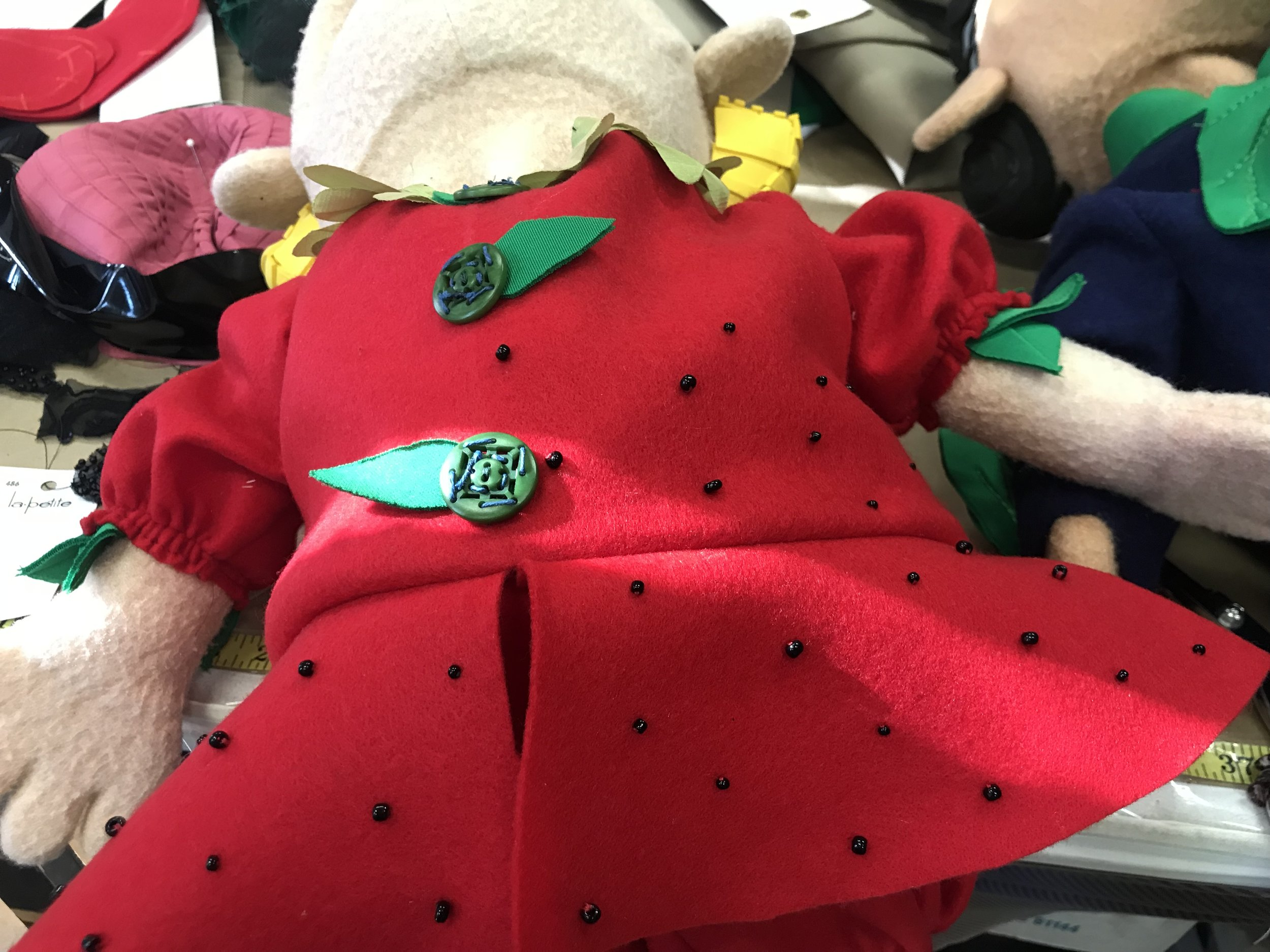 Hand Embroidered Srawberry Munchkin- Wizard Of Oz- Creede Repertory Theatre 2019  Costume Design by Asa Benally. Draping and cutting by Aurora Kenyon.