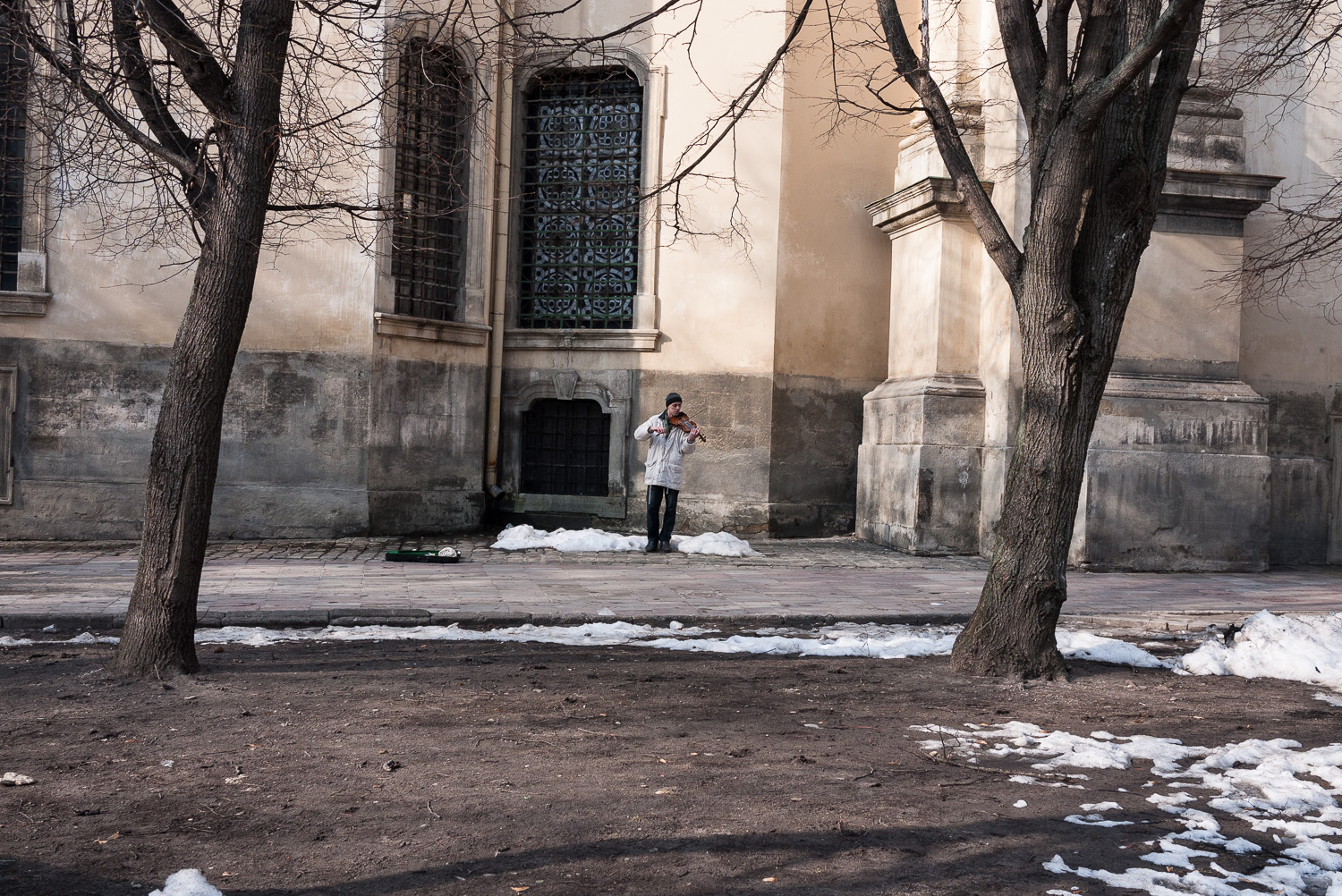 A man plays the violin outside the Dominican Greek Catholic church in Lviv, west Ukraine. The west of the country is home to the majority of the country's Catholic believers.