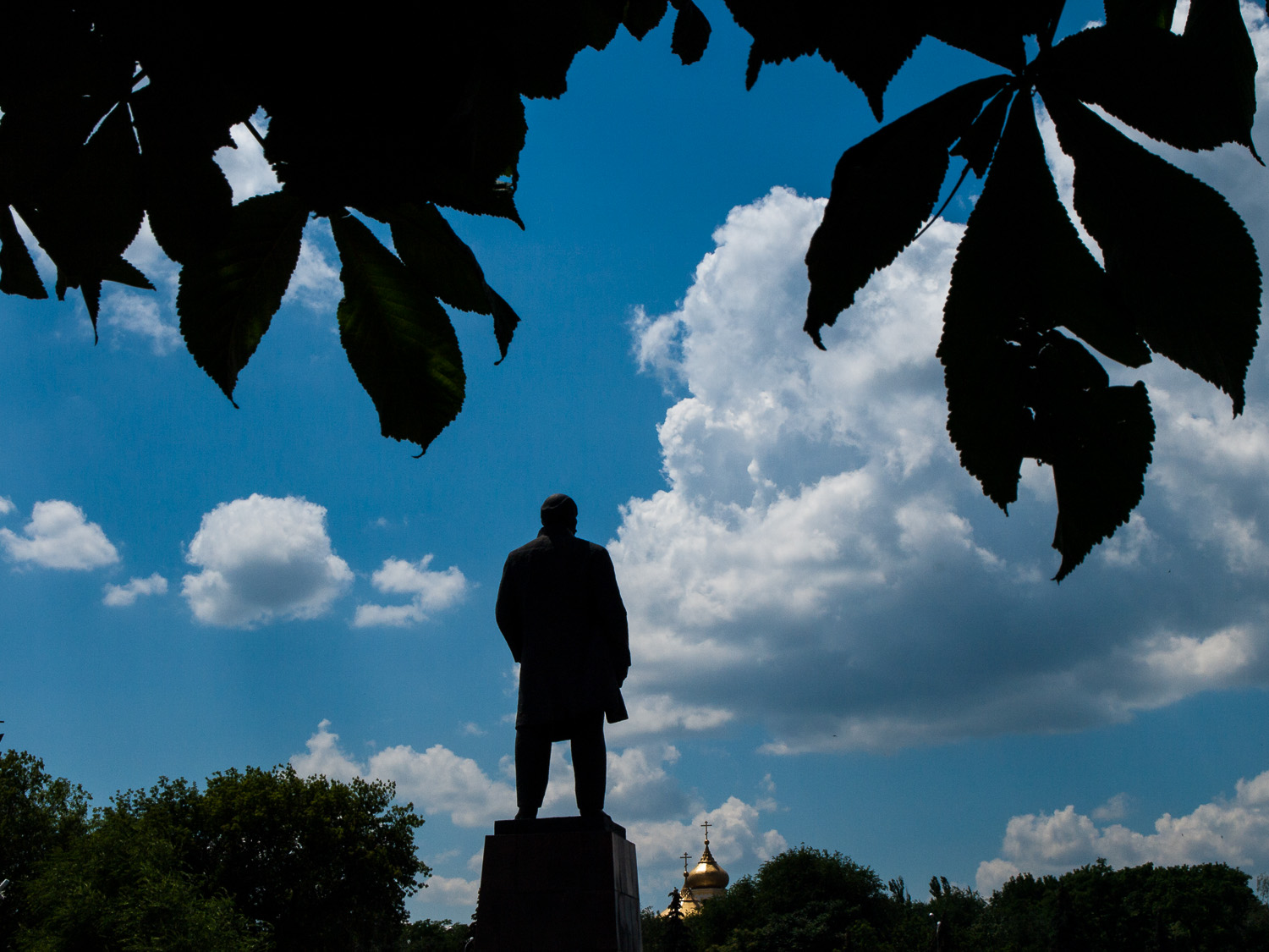 A statue of Lenin overlooks an Orthodox church in the town of Pavlograd. Since the Euromaidan uprisings of 2014, many Lenin statues have been torn down from towns and cities in Ukraine's eastern regions.