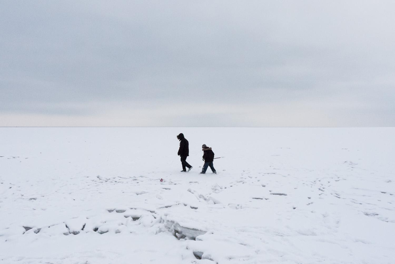 Boys walk on the frozen Azov Sea near the city ofMariupol.
