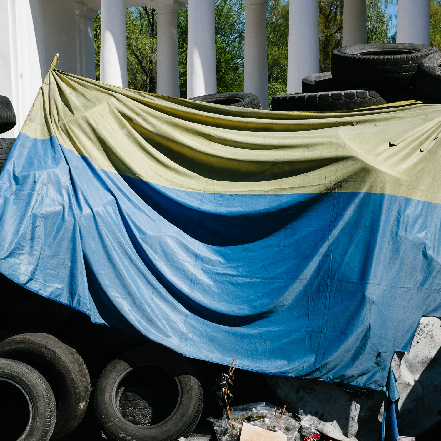 The Ukrainian flag draped over tires left over from barricades built on Hrushevskoho Street during the Euromaidan protests, near Kiev's Independence Square.