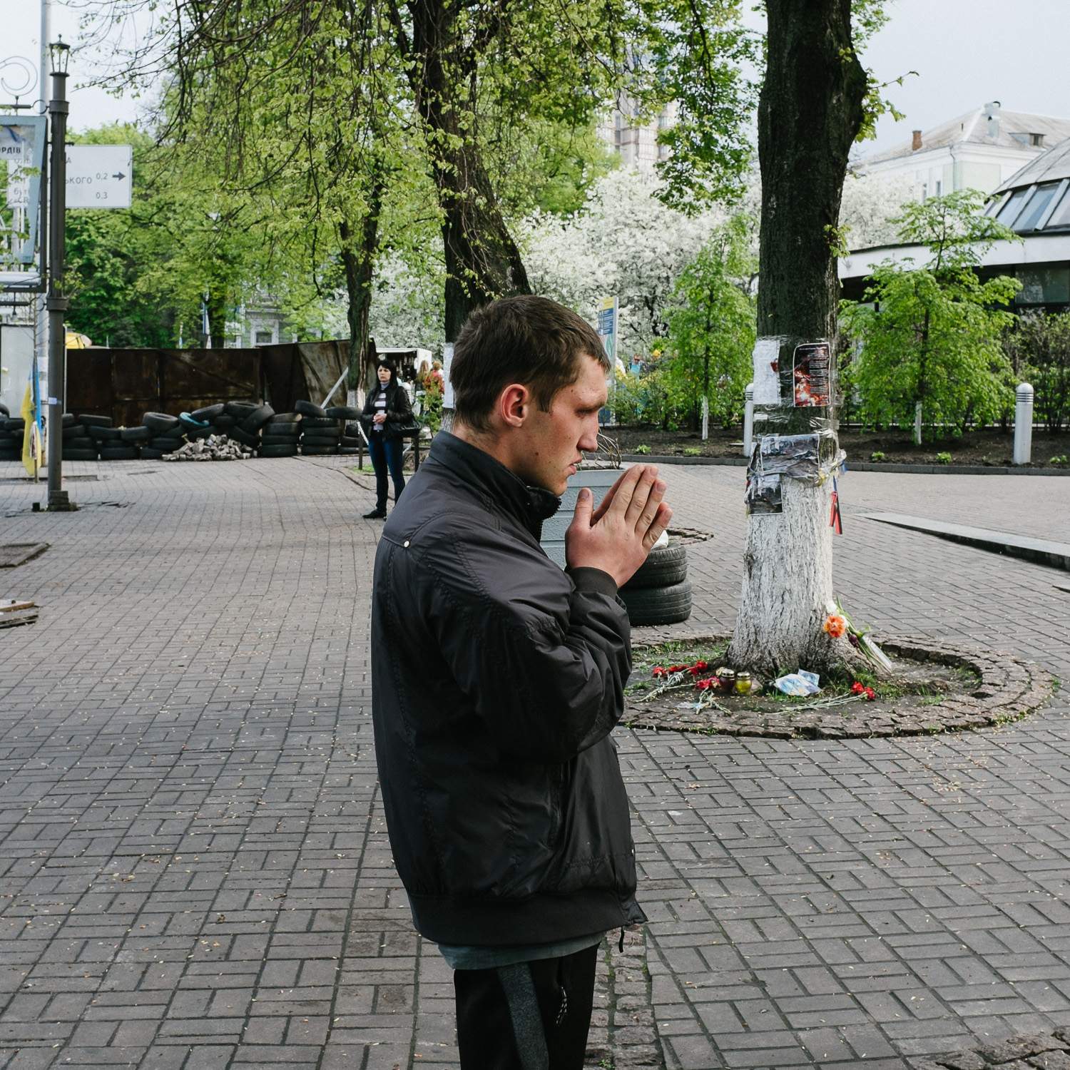 A man prays in front of a memorial to protesters killed in the February 2014 shootings on Kiev's Hrushevskoho Street, off Independence Square, April 2014.