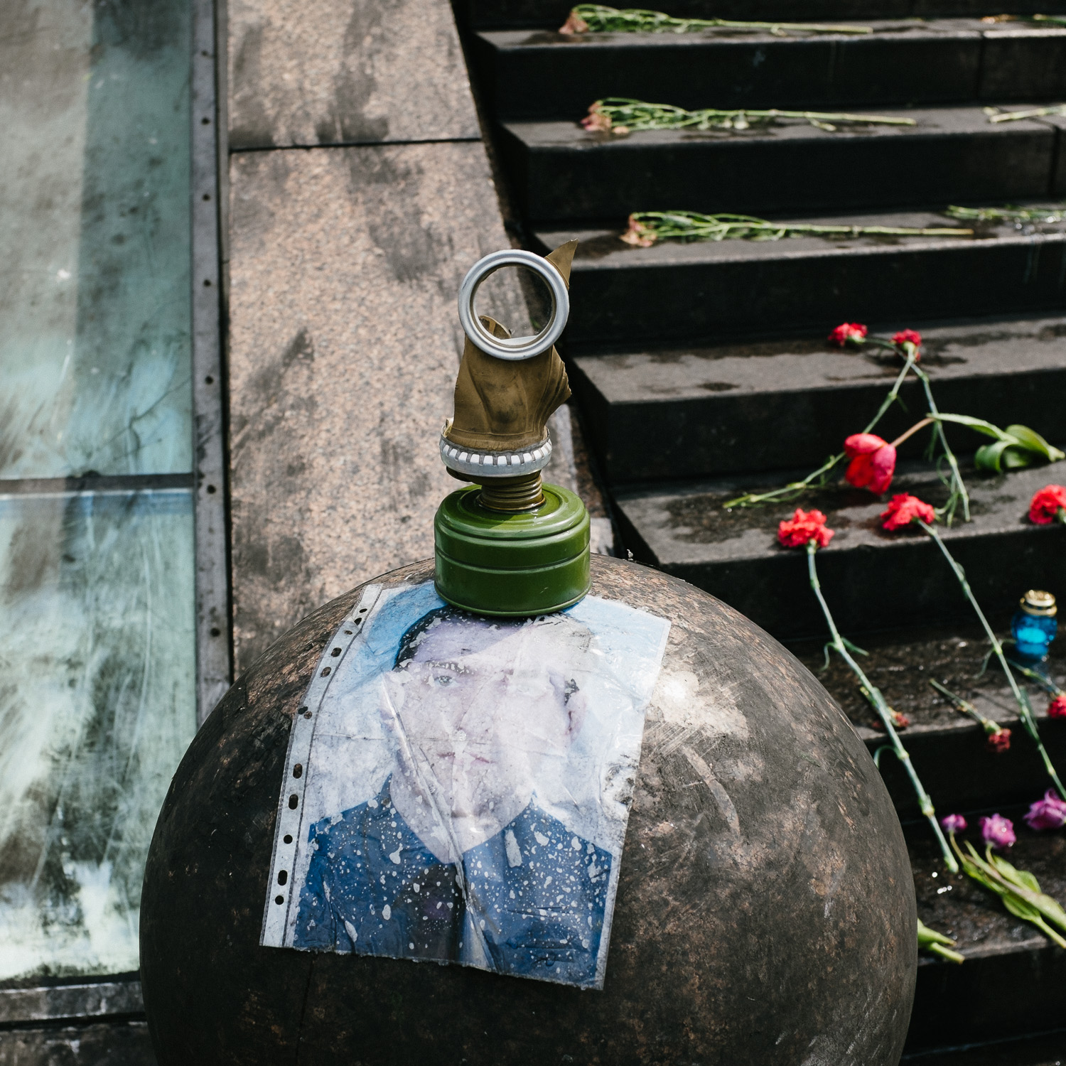 Part of a gas mask sits on top of a portrait of a man in Kiev's Independence Square, April 2014.