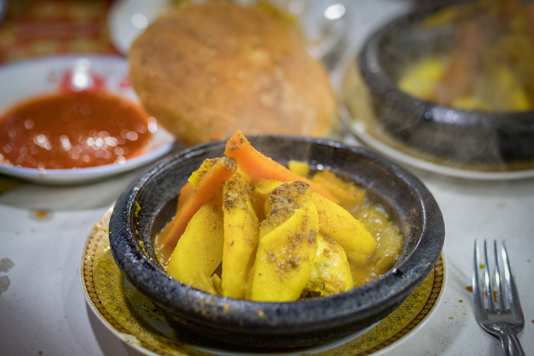 Tajine - A Morrocan dish cooked & served in a clay pot with a variety of ingredients. This one was potatoes, carrots & chicken with various spices.