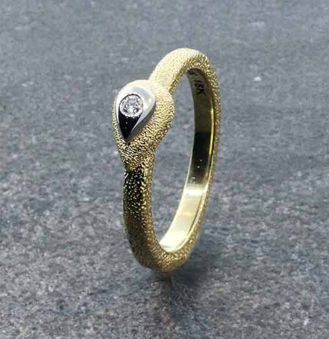 Rhyme & Reason 18k yellow gold and diamond ring, via  Earthworks .