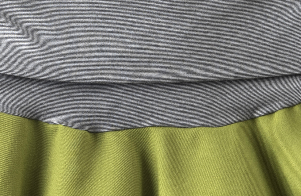 Closeup of the waistband material, which is comprised of tiny stripes of gray and white.  The fabric is wicking, and even when I've been biking on the worst day in July, I've felt very comfortable.