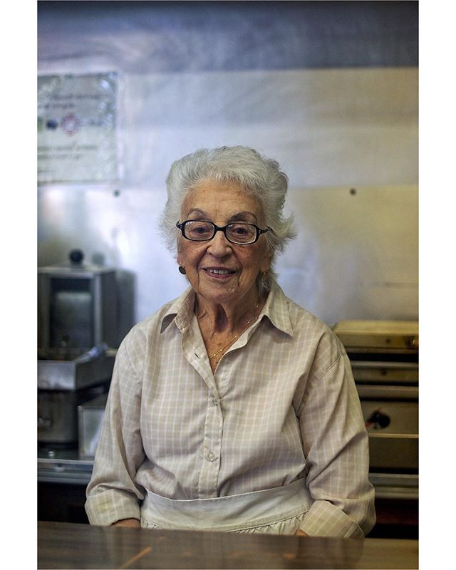 "Ruth Wilensky, Canadian Icon, died on Friday at the age of 98.  Mrs. Wilensky ran Wilensky's Light Lunch, which her late husband founded in 1932, in Montreal's Mile End neighborhood for decades before she retired in 2012.  The only thing you ever need to order at Wilensky's is the Wilensky's Special, a simple pressed salami sandwich with cheese (optional) and mustard (extremely mandatory). That, and a coffee, egg cream or hand-mixed soda to wash it down.  I went to Montreal on spring break in 2012 and had lunch at Wilensky's at least three times. I brought my friend Danny there one afternoon, and he attempted to break to mustard rule (the restaurant has a prominent ""We Always Put Mustard On It/On Met Toujours De La Moutarde where most lunch counters would probably put a TV.) Mrs. Wilensky's daughter, Sharon (who now runs the restaurant,) rebuffed him, but at least agreed to put less mustard on his sandwich.  After we left, we doubled back because I really wanted to take Mrs. Wilensky's photo. When I asked, she said to come back in a half hour when she was done with lunch. Thirty minutes later, she very politely indulged me, having surely dealt with the same request from decades-worth of idiot tourists before me.  #Montreal #MTL #Wilensky #Wilenskys #WilenskysSpecial #WilenskysLightLunch #Quebec #Mustard #Moutarde #Sandwich #Deli #OnMetTourjoursDeLaMoutarde #SpringBreakWoo #MakePortraits"