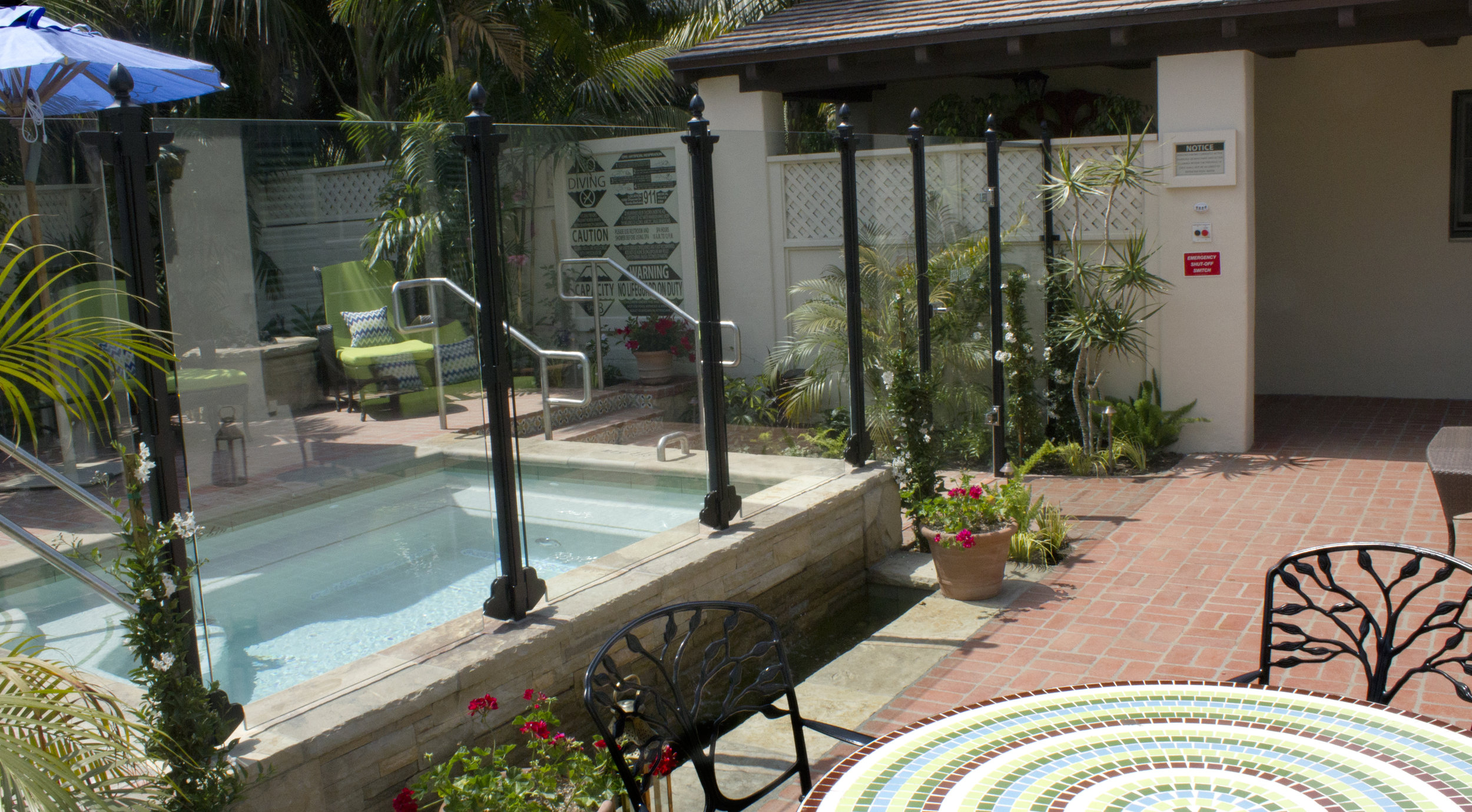 Recently completed spas for a local resort, creating private patio spaces.
