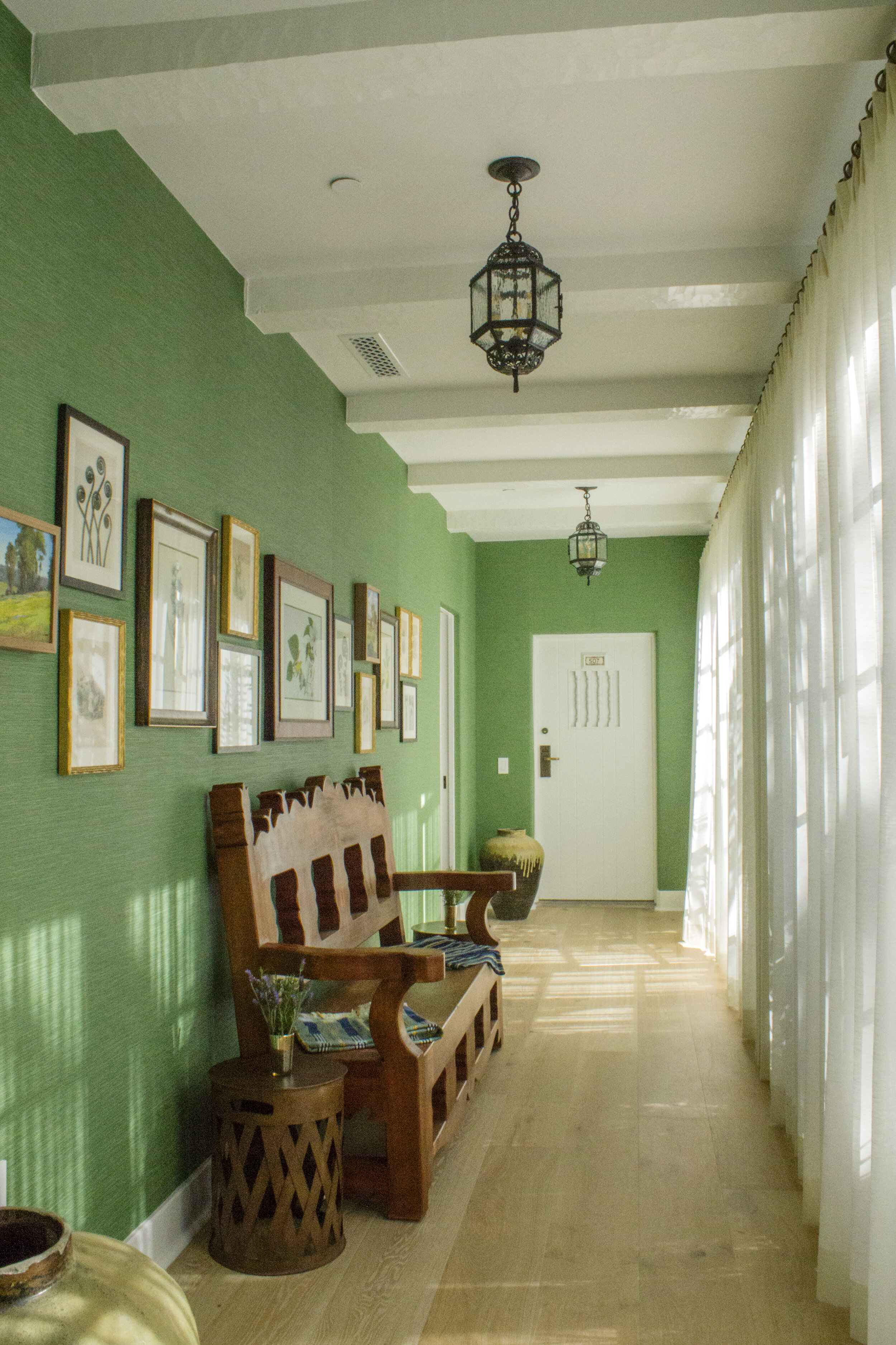 Cool green hallway, adding a dominate visual interest without overpowering the minimalist design.