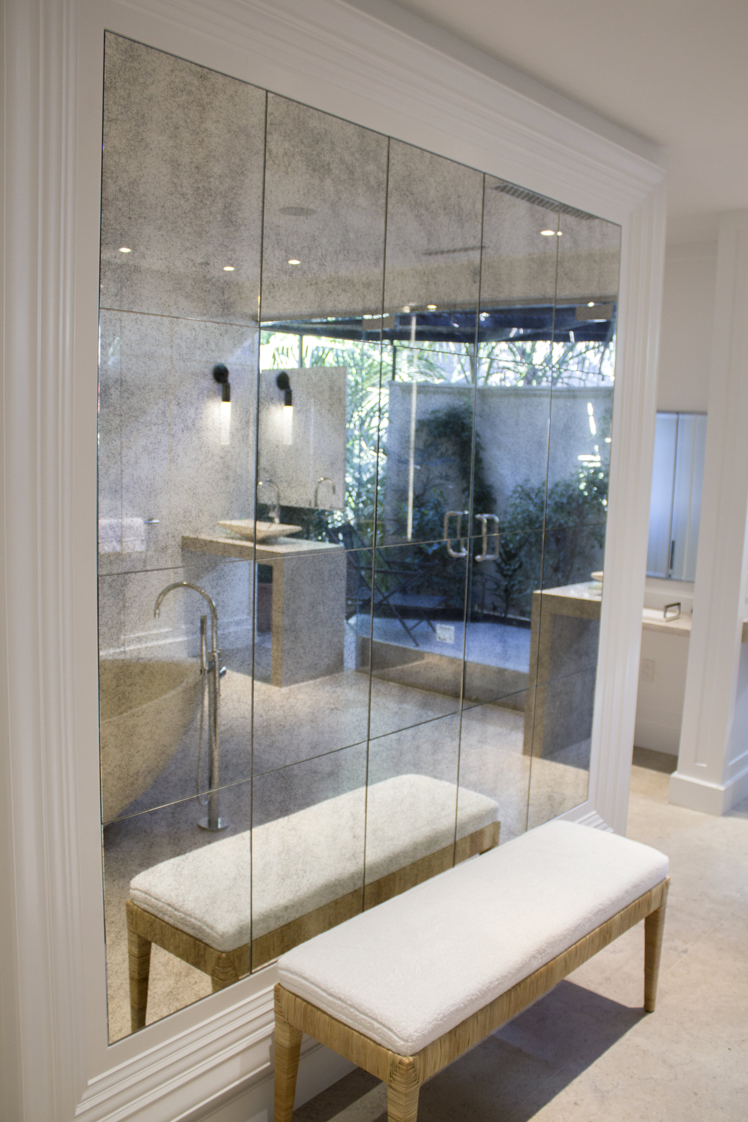 Uncluttered, minimalist bathroom design. Large mirror tiles creating the feeling of a much bigger space.