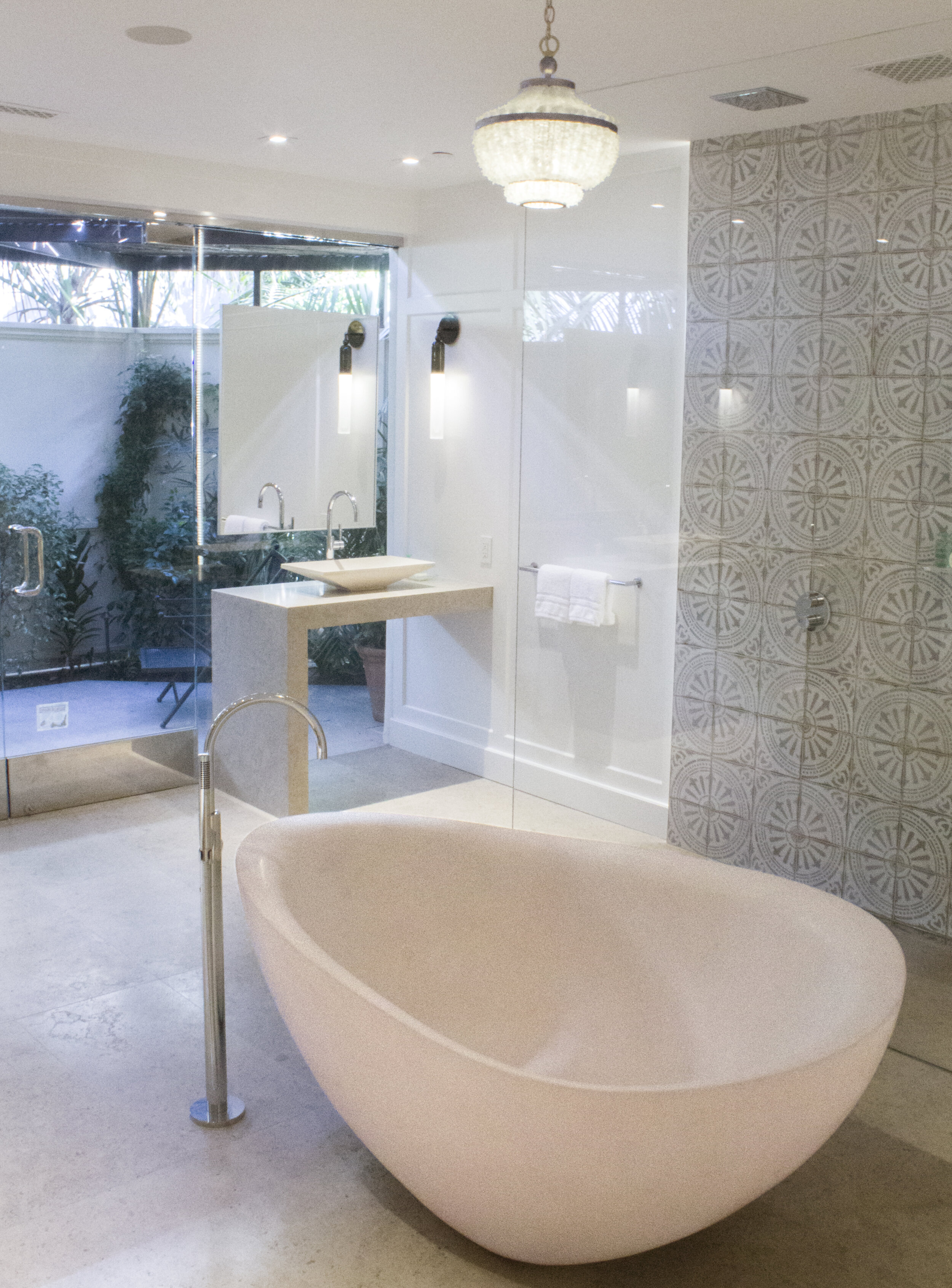 Free standing tub and walk through shower help to create and even more open feeling in this elegant bathroom.