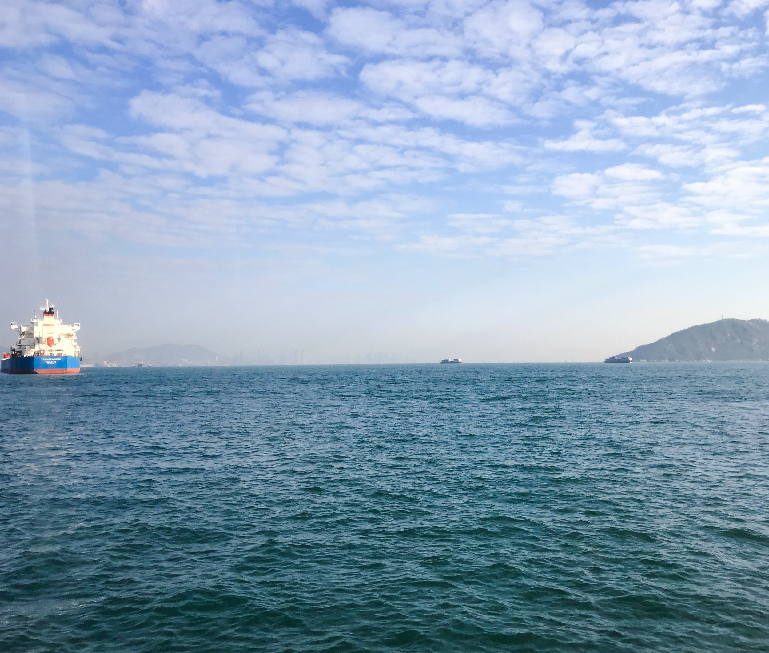 Leaving the competition in Macao I took a very early morning ferry to Hong Kong harbor, where I was able to catch this serene view.