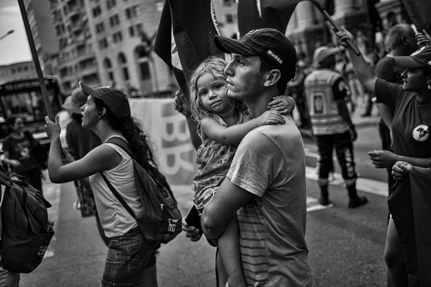 A young family from the landless workers movement march in Rio de Janeiro in support of Petrobras, the state run oil company. In recent weeks, the company has been embroiled in one of the largest corruption scandals in the nations history. Rio de Janeiro, Brazil, 03-13-2015.