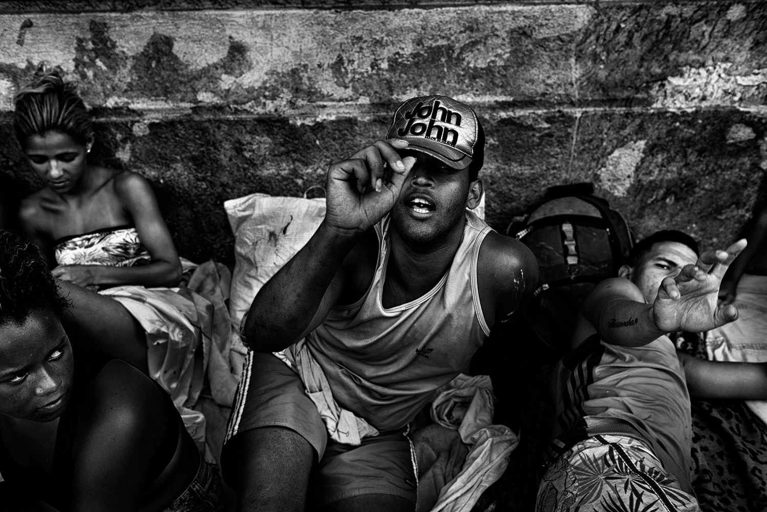 Recently evicted from an abandoned lot in downtown Rio, a now homeless man begins to spontaneosuly pose for a portrait.