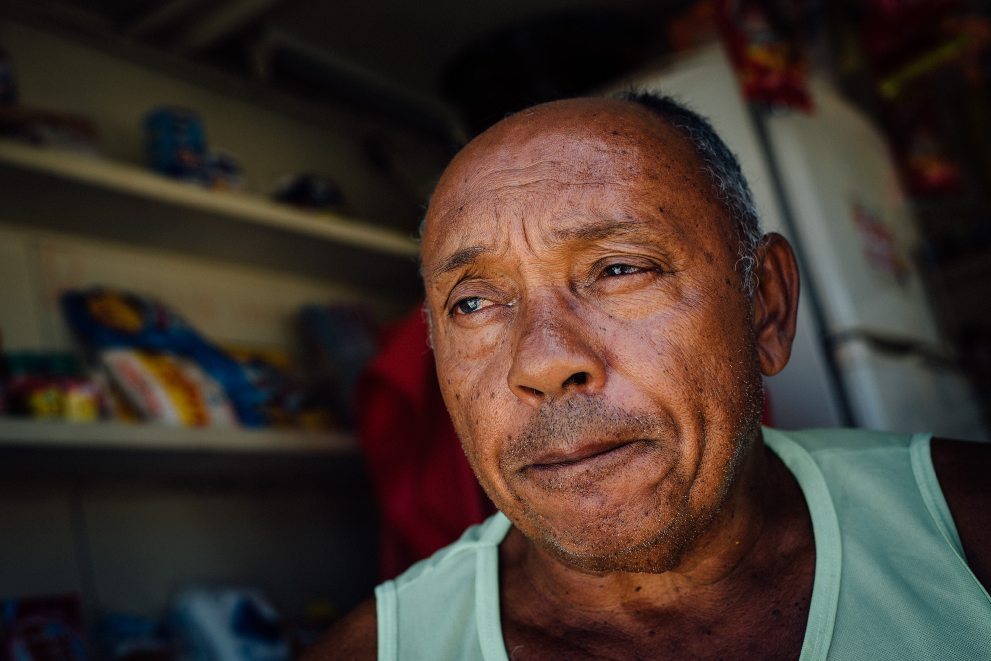 Cicero dos Santos, 64, talks about his life. Dos Santos says it's been hard adapting to life in rural Paraiba state after moving from Sao Paulo only one month ago to be with his girlfriend. Dos Santos manages a small shop where he sells everything from potato chips to batteries to keys.
