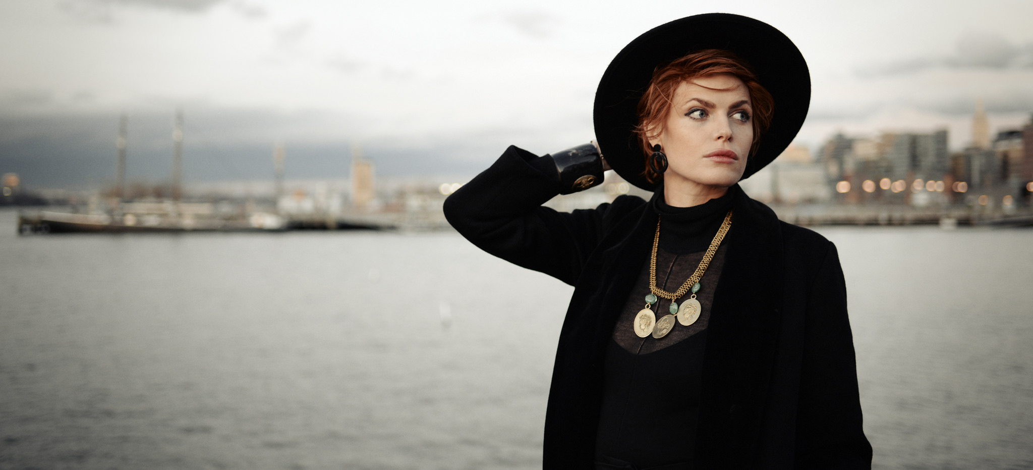 Christina wearing Cameo Cuff & Necklace with Nuba Earrings. Photo by Eftihia Stefanidi, New York