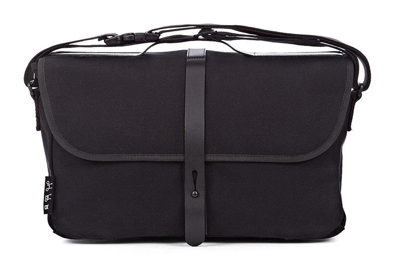 shoulder bag  -Teflon-coated heavy canvas cotton -Quick-adjust shoulder strap -Internal pockets -reflective rain cover  -9 Litres