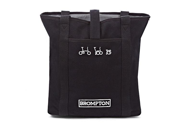 tote bag black  -Teflon-coated cotton canvas -Quick-access Velcro fastening -Internal zip pocket -reflective rain cover  -280 x 300 x 110mm  Black,Turkish Green or Cherry Blossom finish