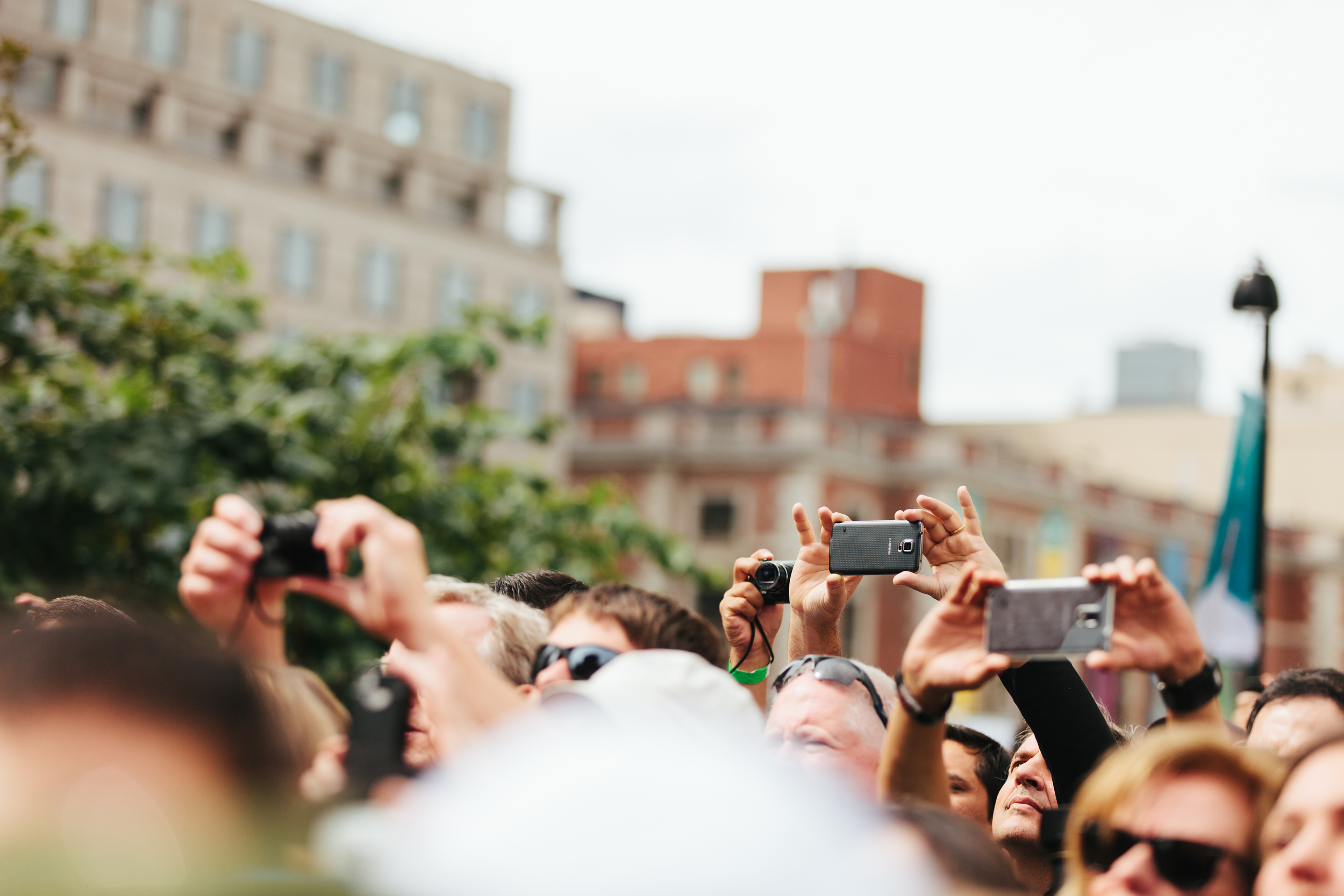 People's Phones Out Watching Pope Francis