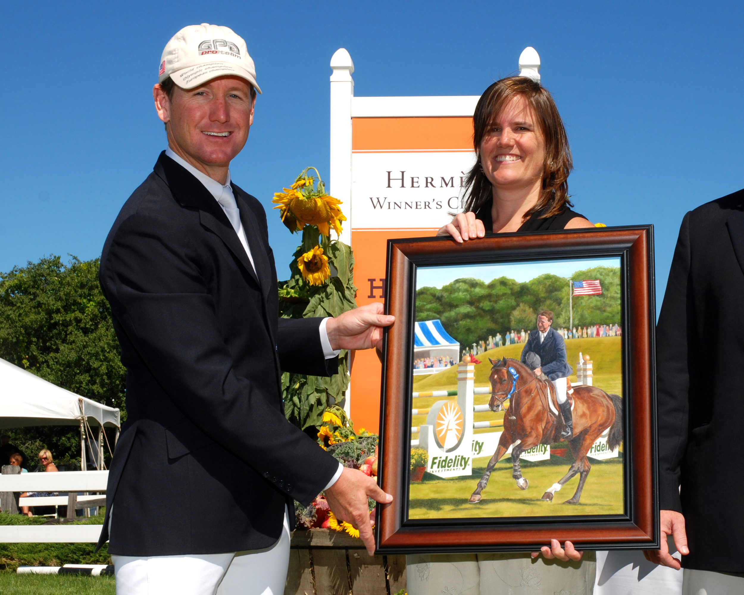 Gretchen presenting Gold Medalist Mclain Ward the painting she did of him on Goldika for the Fidelity Investments Jumper Classic, Hampton Falls, NH 2010.