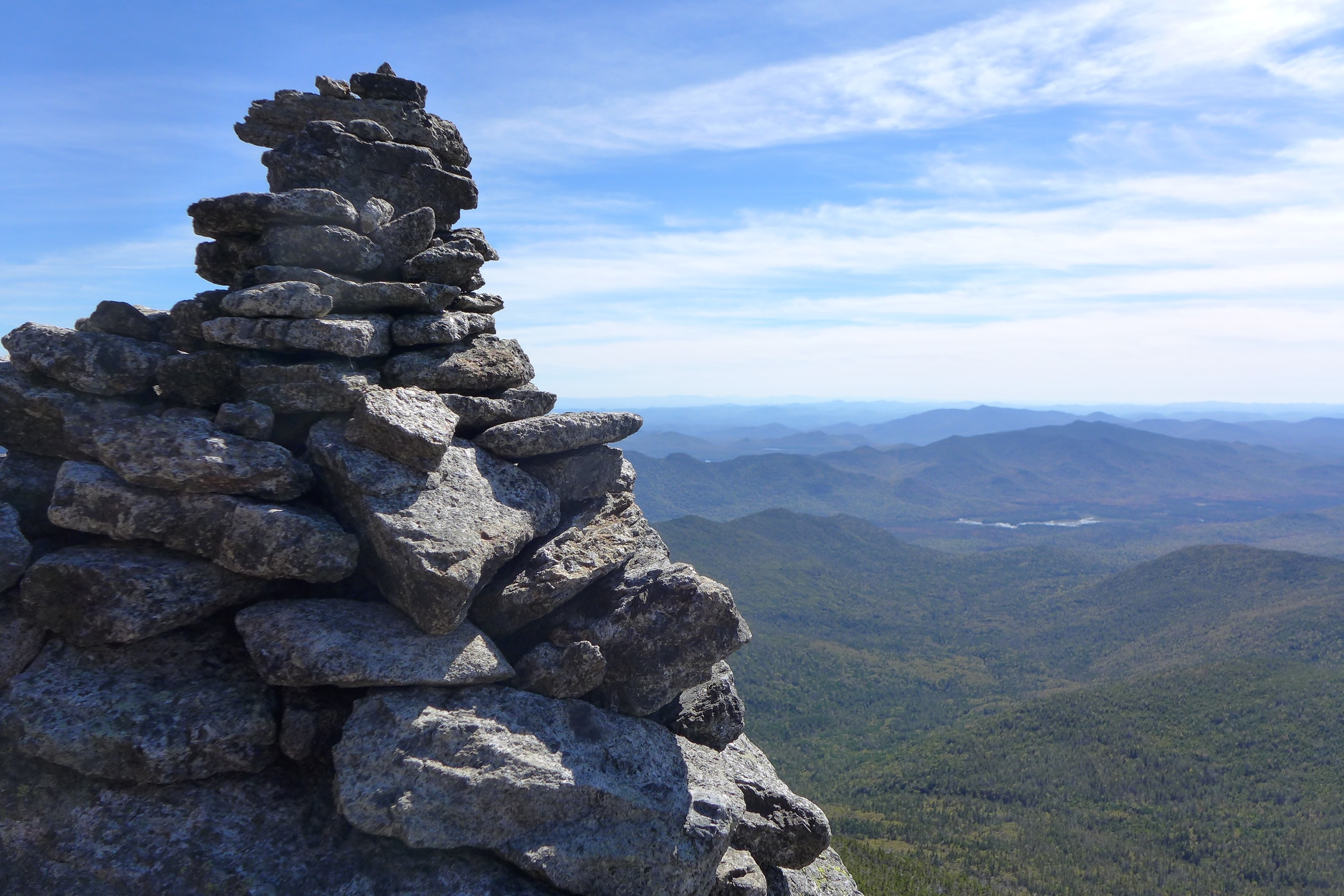 Cairns to show you the way, blue ridges to get you lost in your thoughts on top of Mount Marcy, High peaks region of the Adirdondacks @ ateliermileaway.com