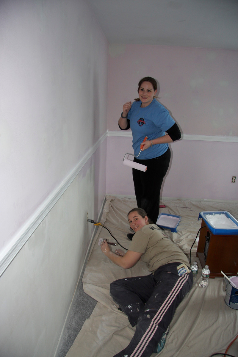 Annmarie and Sandy working hard on painting the room!
