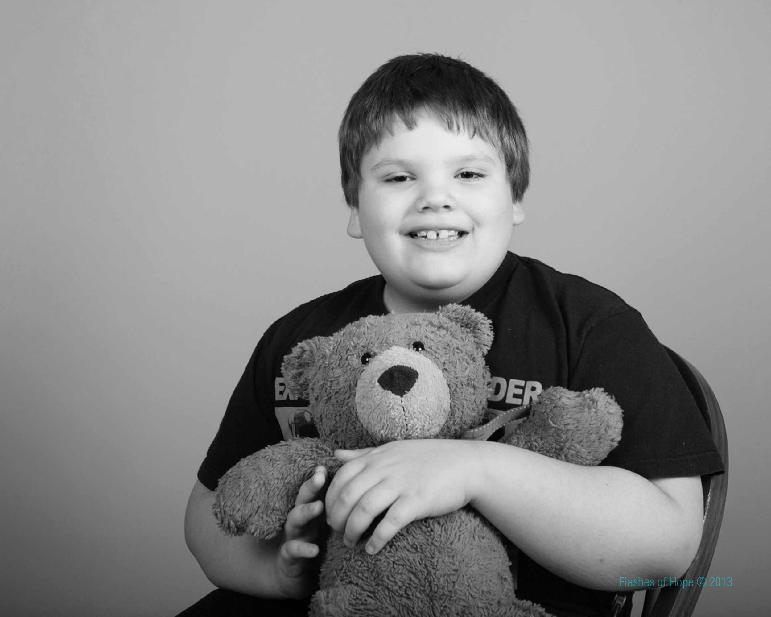 """Seth and his best bud, """"Teddy with a Red Ribbon"""" who has been through every surgery and milestone with him."""