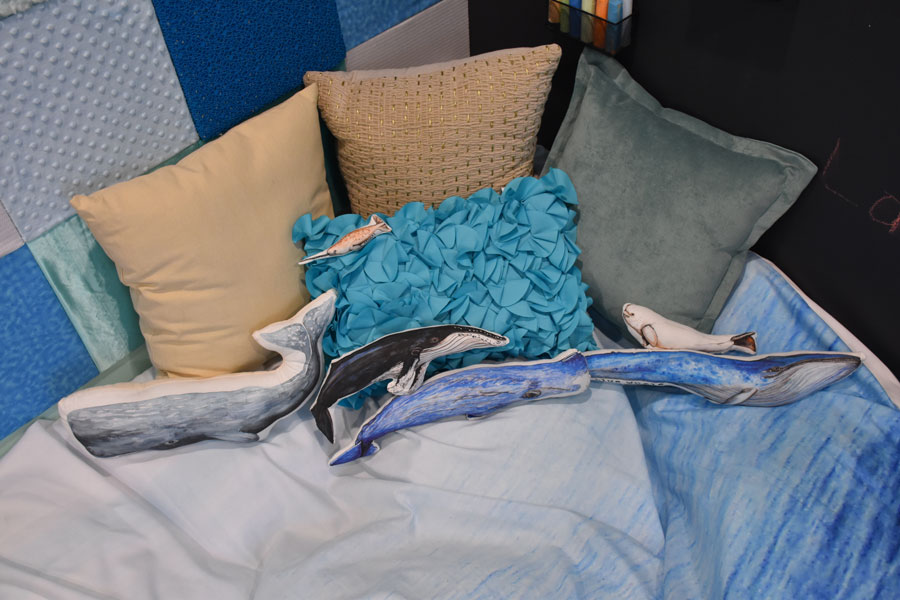"Beautiful whale pillows to help calm him down while ""crashing"" in his personal ocean"