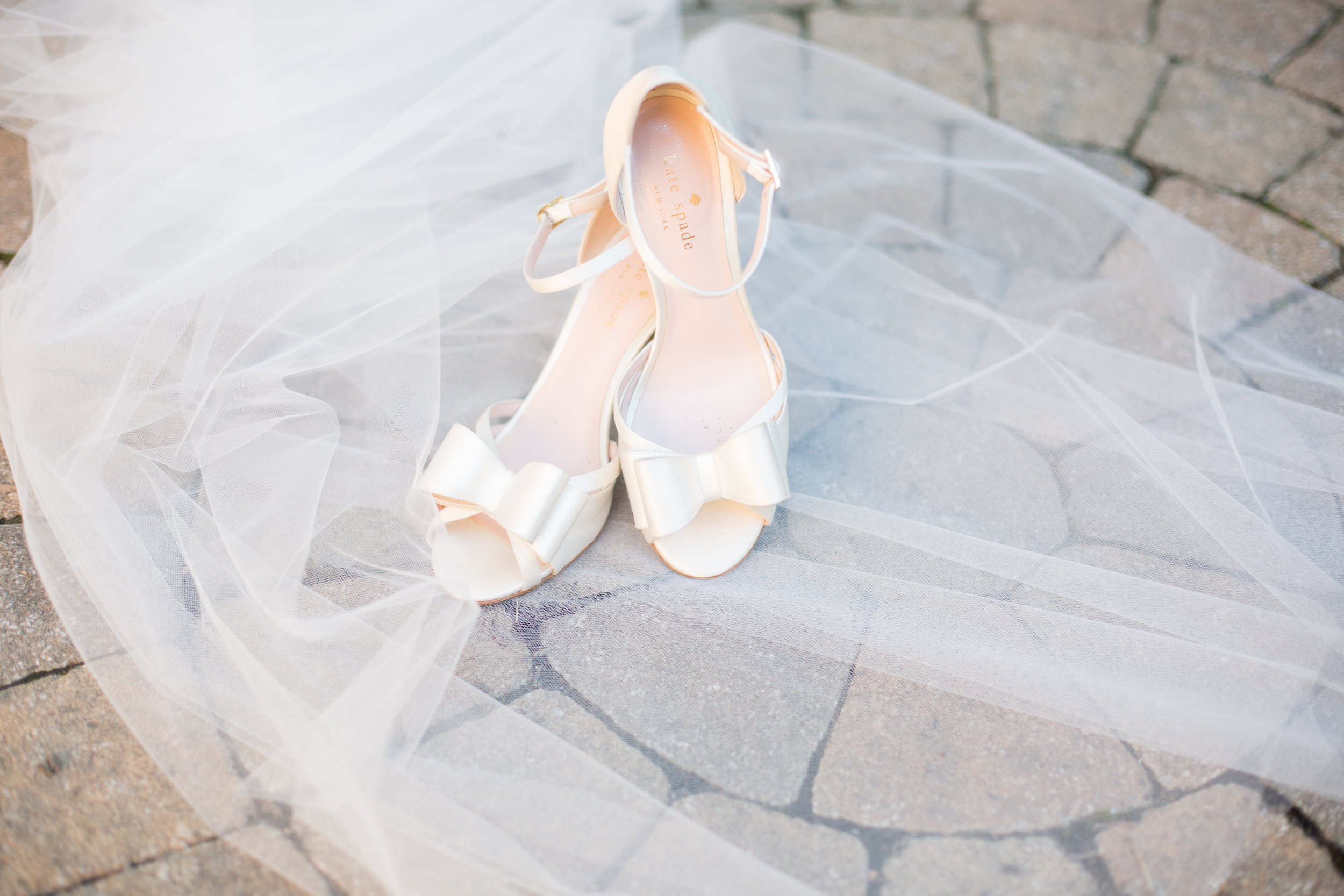The classical white satin wedding shoes.