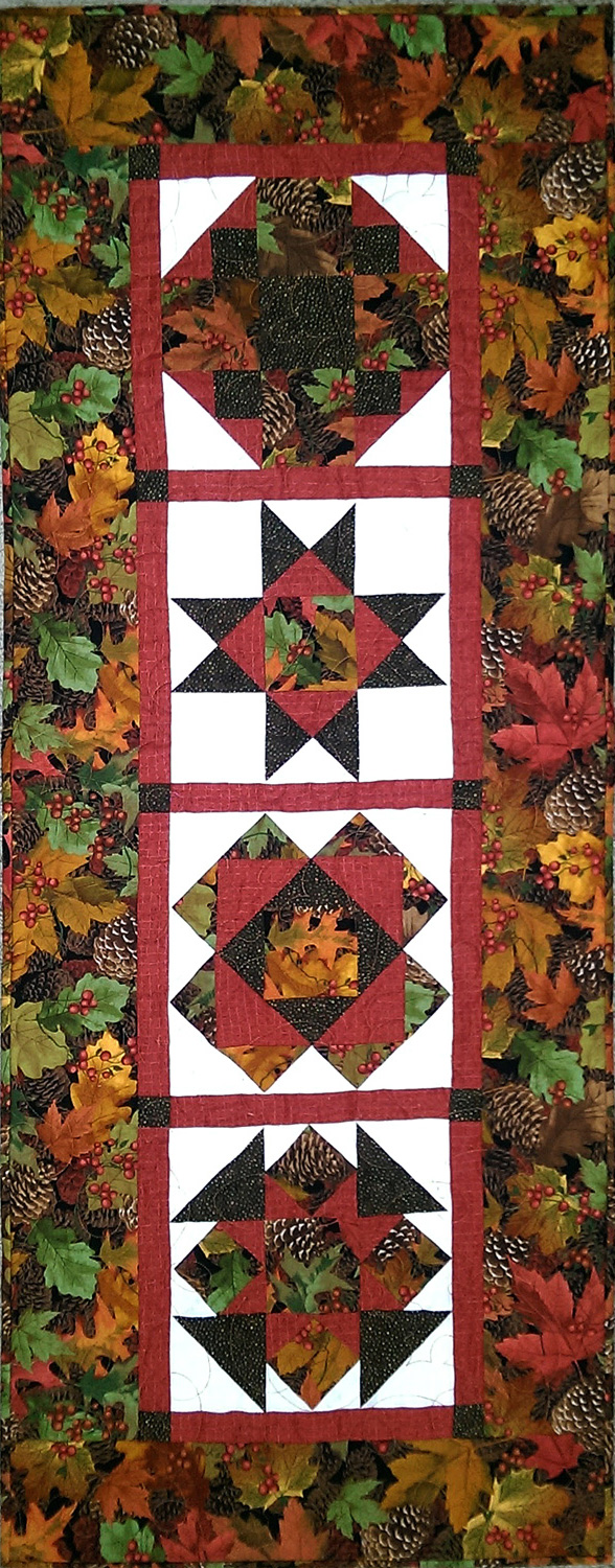 Fall colors make this runner a perfect appointment for your Thanksgiving table.