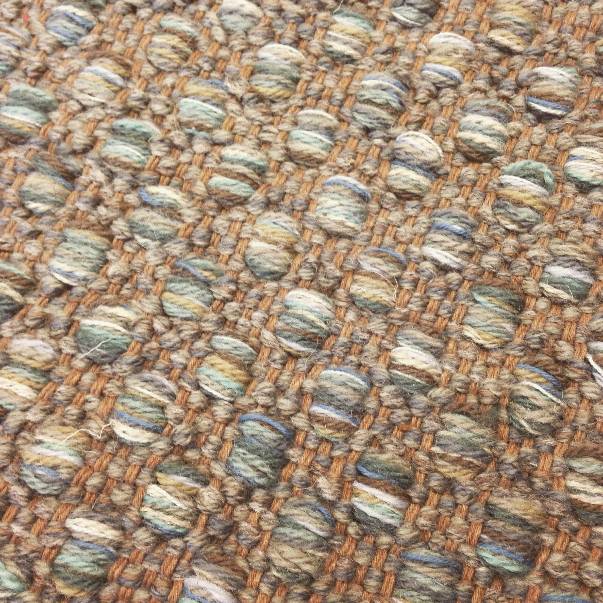 Fresh color of our Mosaic handwoven rug.
