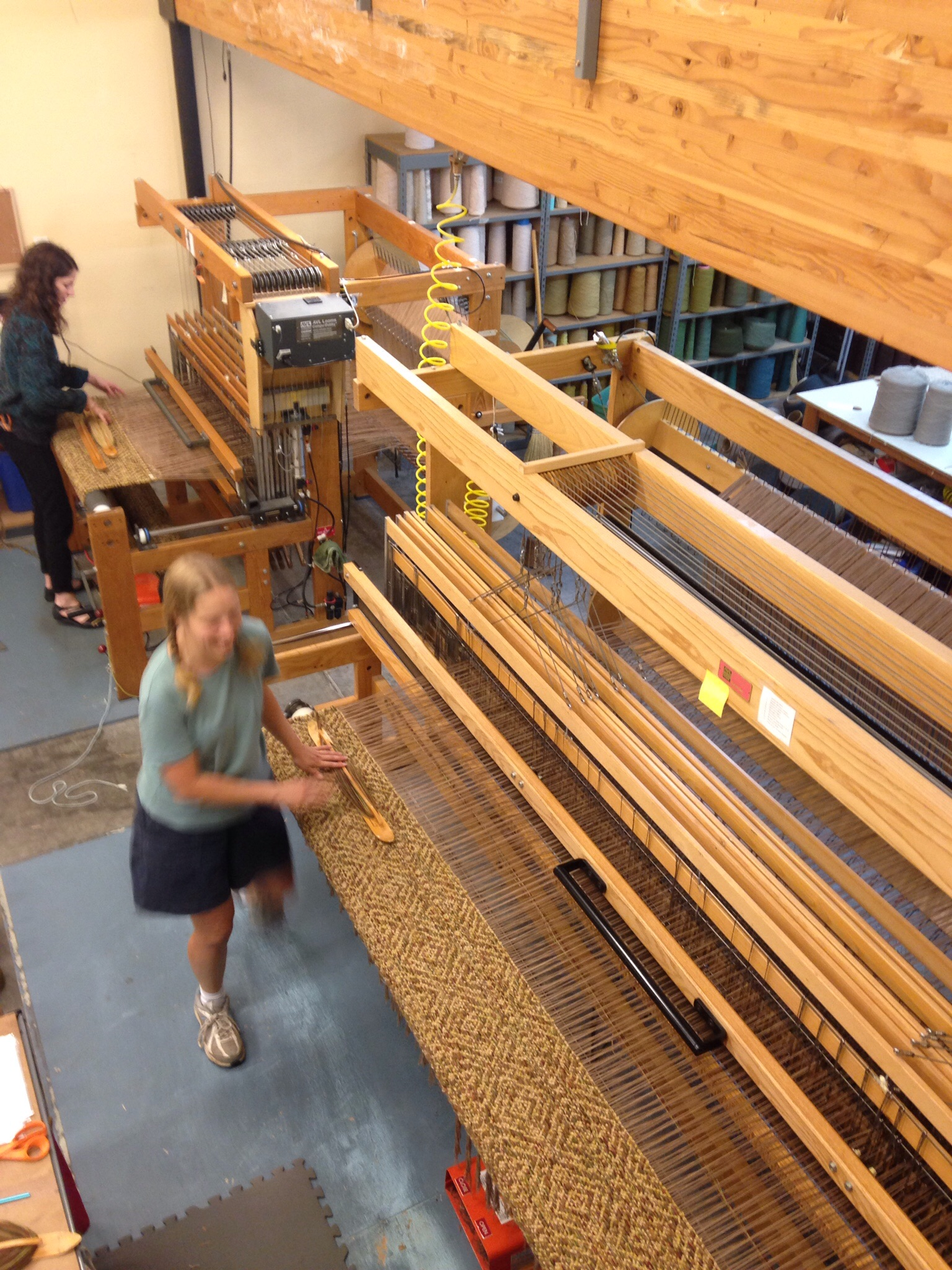 Aurora and Meg weaving rugs.