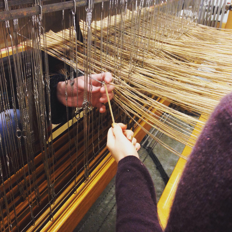 Meg and Kate threading the loom
